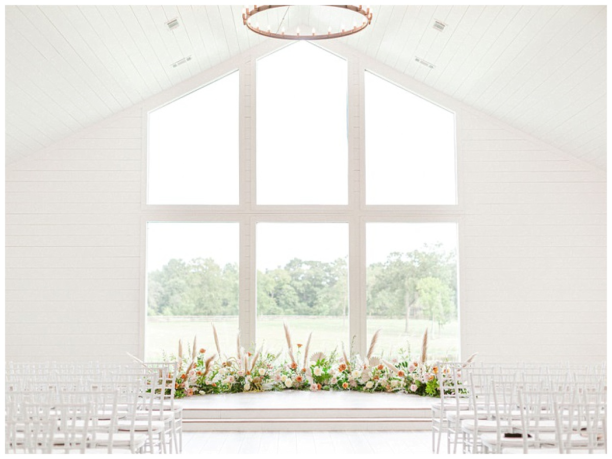 The Chapel windows with floral decorations | The Farmhouse Events Real Weddings | A Summer Vision of Love | Kristin & Rob