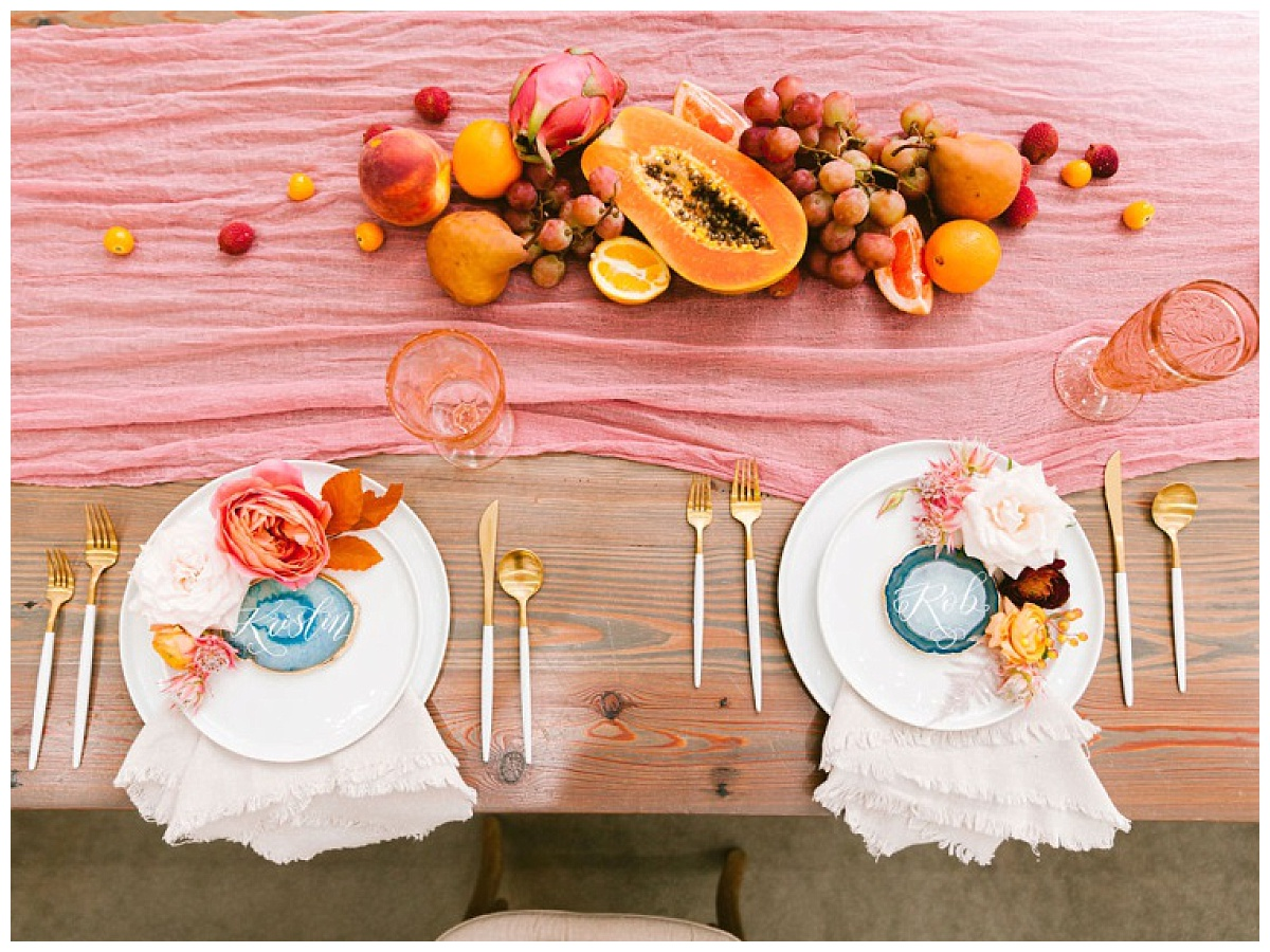 top shot of bride and groom place setting wit custom name plate and fruit spread decor | The Farmhouse Events Real Weddings | A Summer Vision of Love | Kristin & Rob
