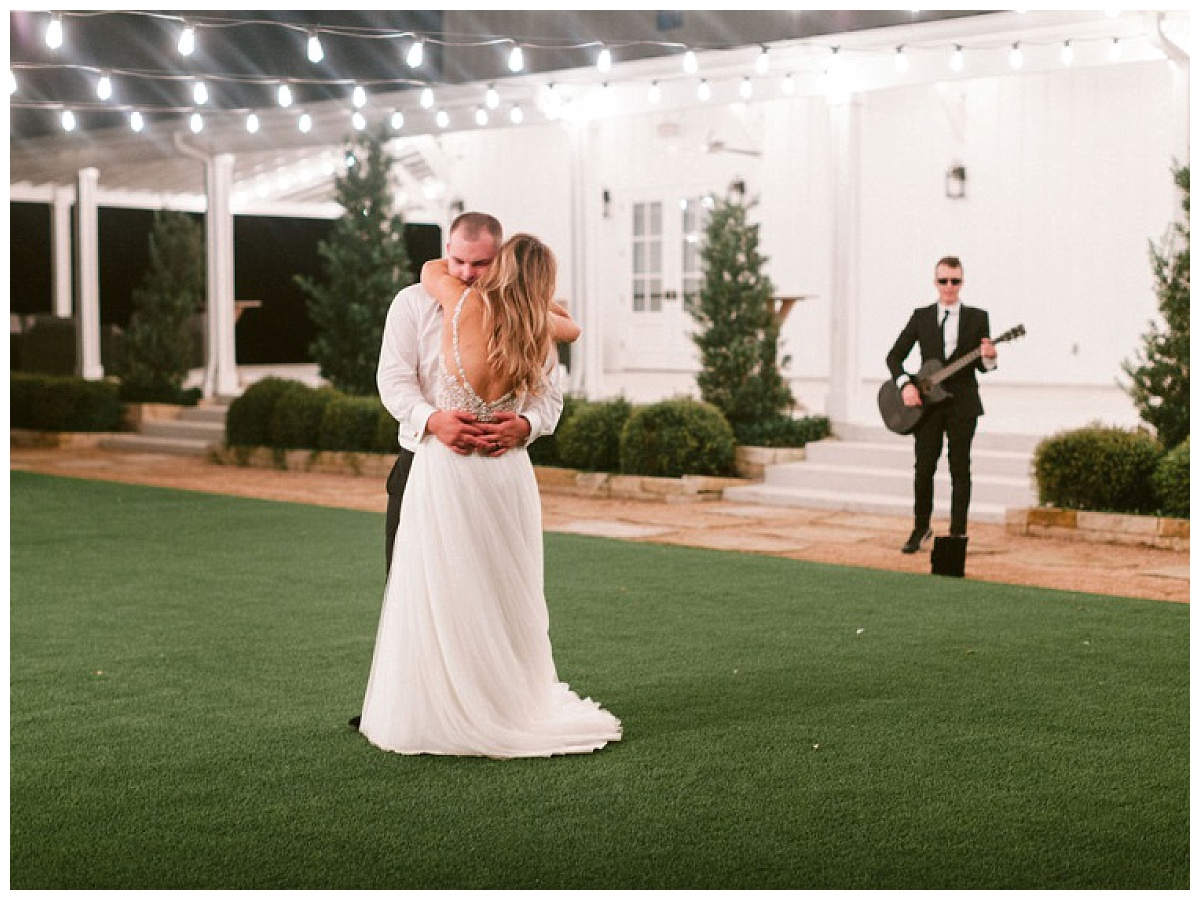 private last dance in courtyard with guitarrist and cafe lighting | The Farmhouse Events Real Weddings | A Summer Vision of Love | Kristin & Rob