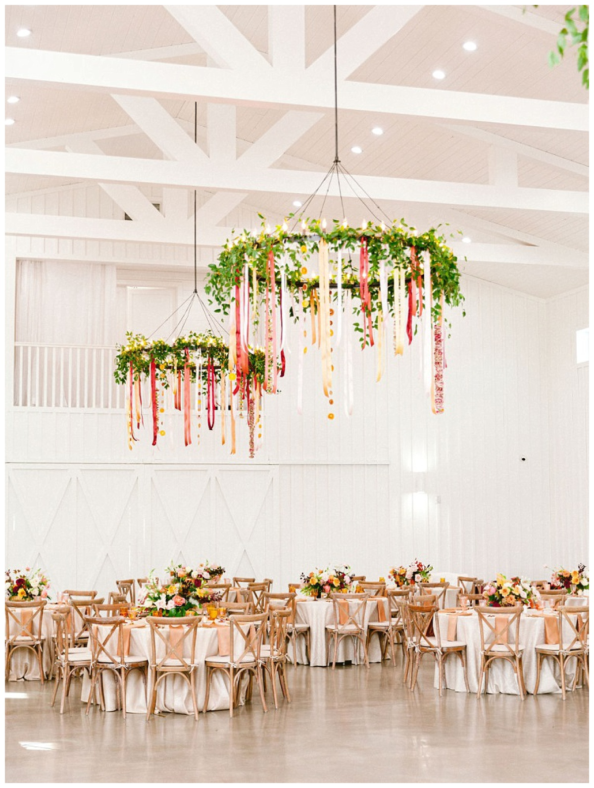 Full Reception space view of decorated tables and chadeliers | The Farmhouse Events Real Weddings | A Summer Vision of Love | Kristin & Rob
