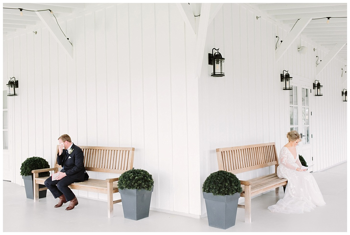 Bride and Groom sitting reading letters | The Farmhouse Events Real Weddings| A Little Something Blue| Kelly & Jarrod